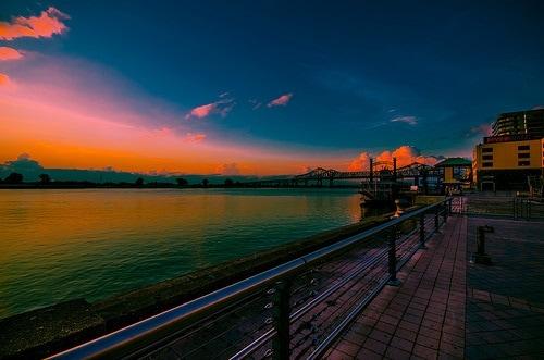 A waterfront boardwalk at sundown.