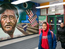 A mural of César Chávez welcomes students at the Chicago elementary school bearing his name.