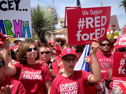 Educators and supporters marching at a #RedforEd rally.