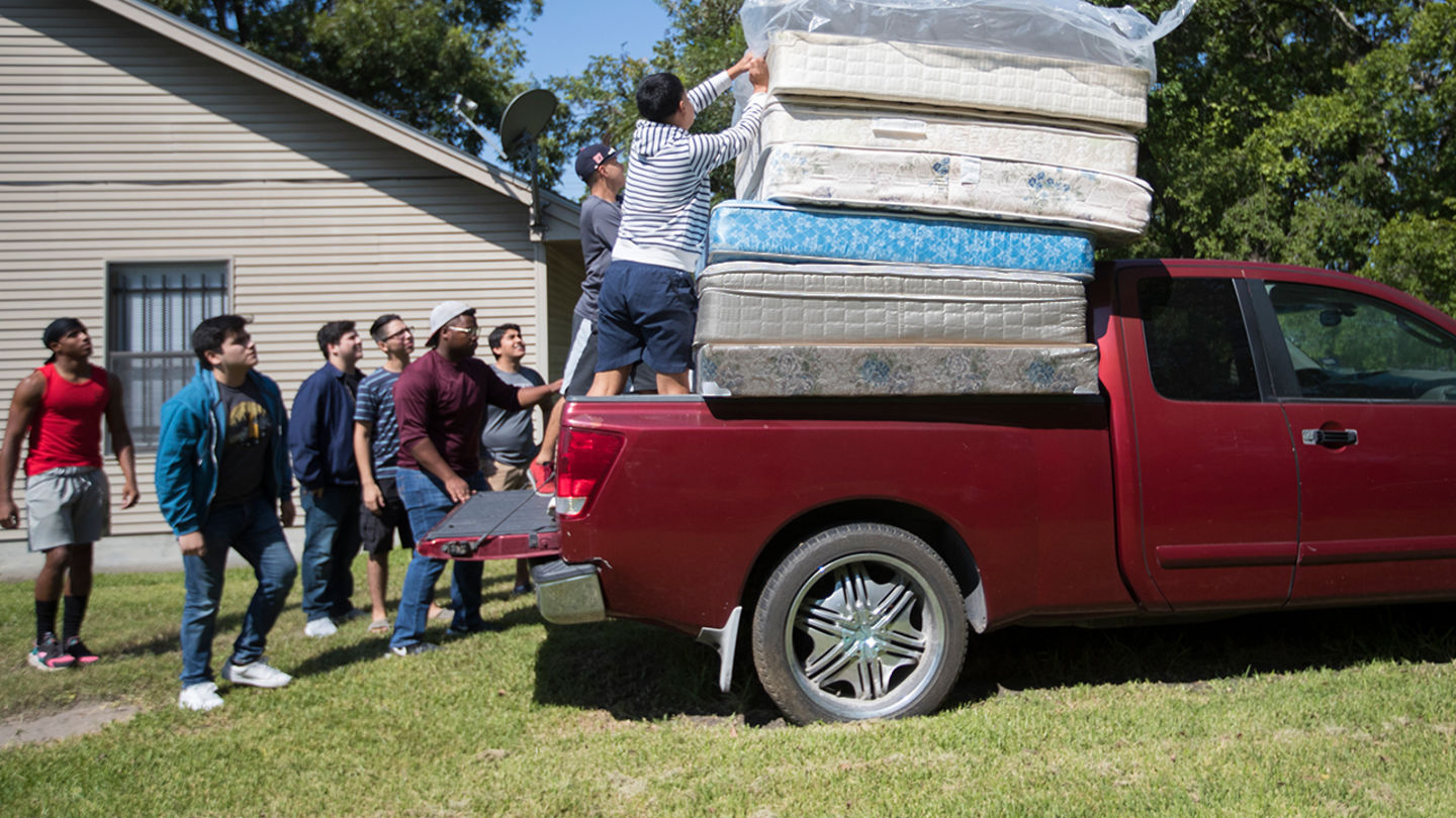 Mattresses being stacked on a truck