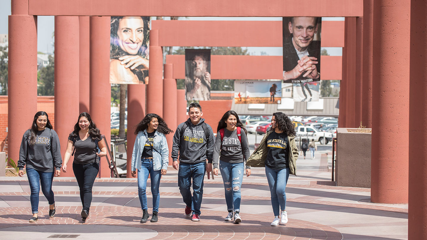 A group of students walking through Cal State LA campus