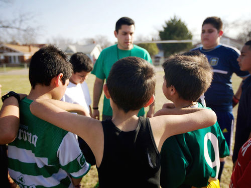 A Teach For America corps member coaching an after school sports program.
