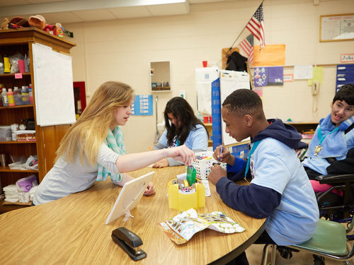 A Teach For America corps member leading a class of students with disabilities.