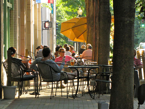 People sitting outside of a restaurant in Charlotte, NC.