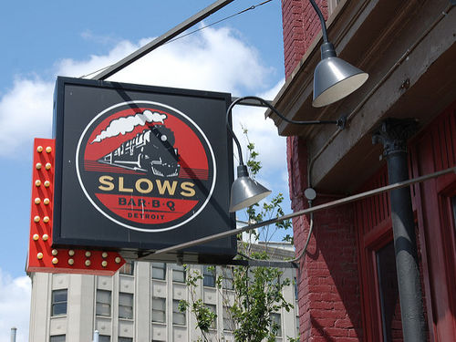 A sign outside of Slows BBQ restaurant.