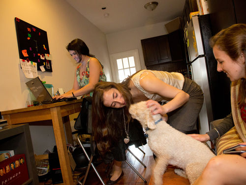 Alicia Escobar (New York City '12) and other TFA corps members in her apartment in Crown Heights, Brooklyn.