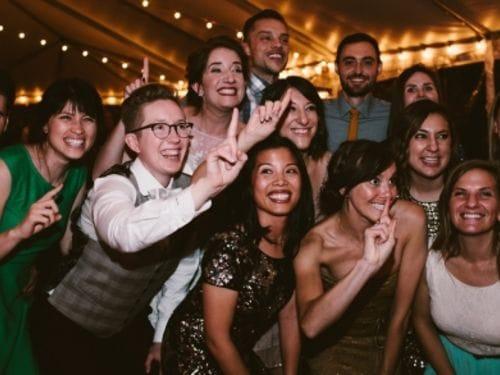 TFA alumni and friends celebrating at a wedding reception.