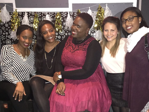 A group of Teach For America alumni, celebrating at the Charlotte Collective Winter Social event.
