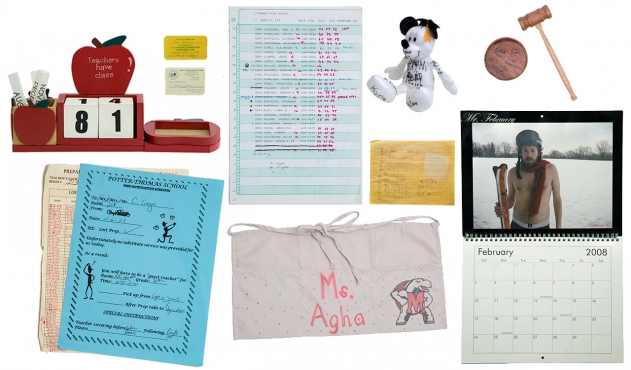 "A photo of several artifacts: ID cards, a monthly calendar, an apron that reads ""Ms. Agha,"" a few report cards, a stuffed bear with a graduation gap, and a judge's gavel."