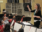 Students from Landrum Middle School and KIPP Courage (right) join together in the band.