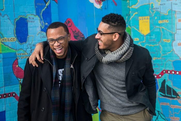 Tamir Harper (left) is a high school senior. Sterling Grimes (right) teaches high school English.