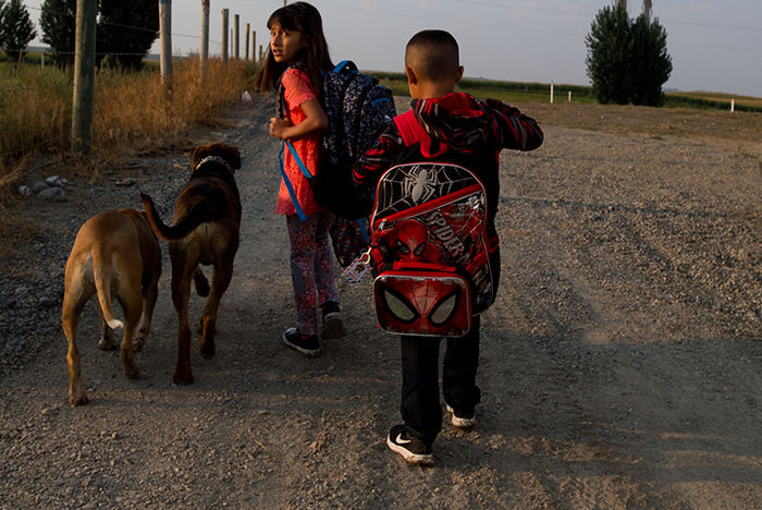 Two young children walking down a dirt road in Central Washington.
