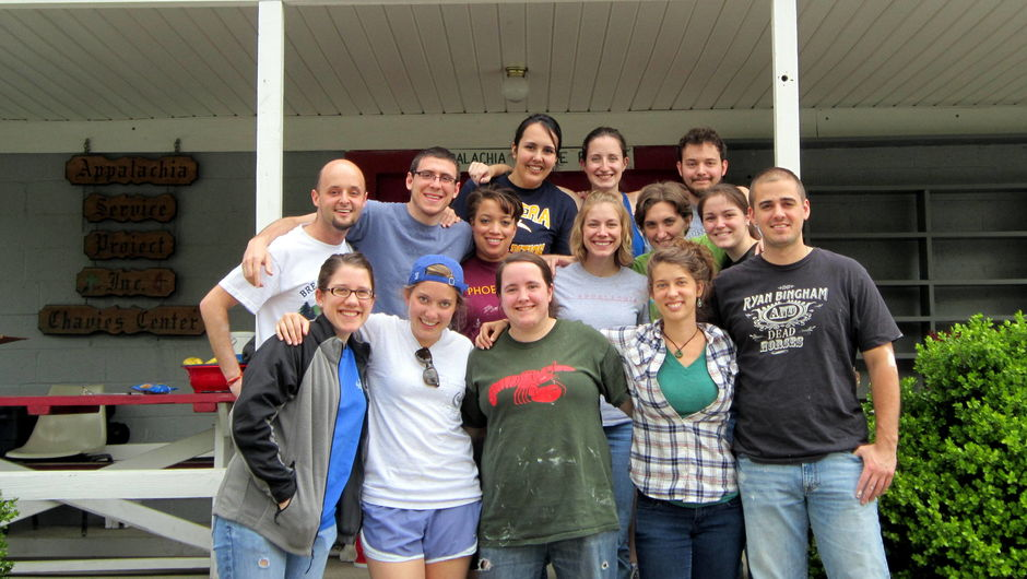 Appalachia corps members and alumni standing in front of the Appalachia Service Project building.