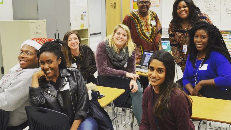A group of Metro Atlanta corps members sitting in a classroom.
