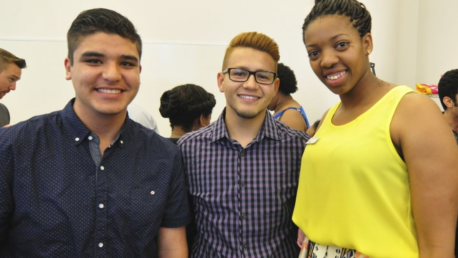 Manny Macias (Los Angeles '13) in between his student Mike* (left) and a representative from The College Initiative, whose organization recently awarded Mike with a scholarship to UC Berkeley.