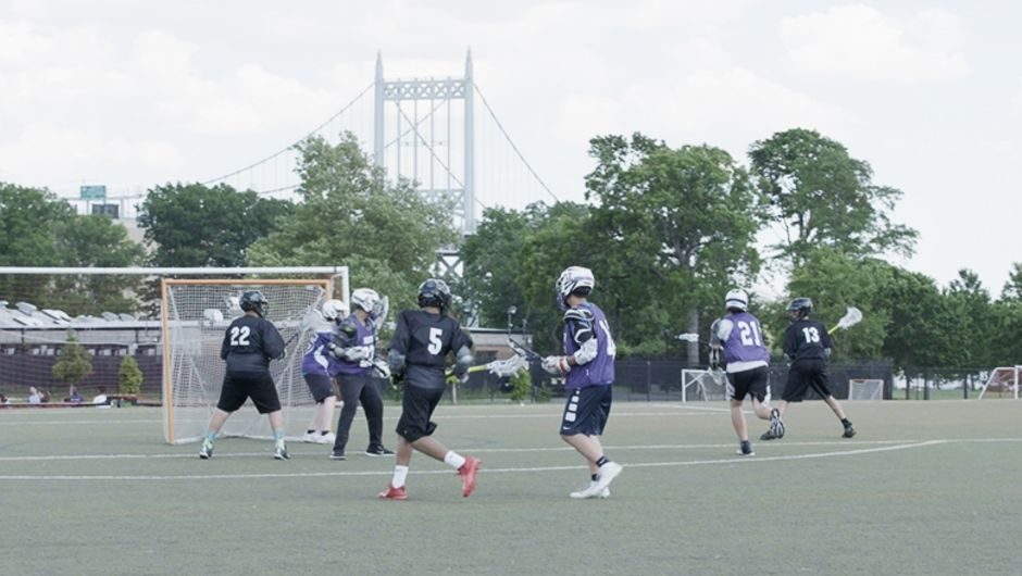 A high school football team plays out on the field.