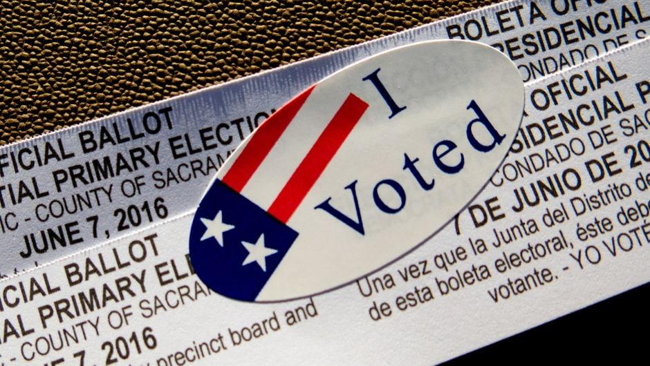 "A ballot receipt with an ""I Voted"" sticker."