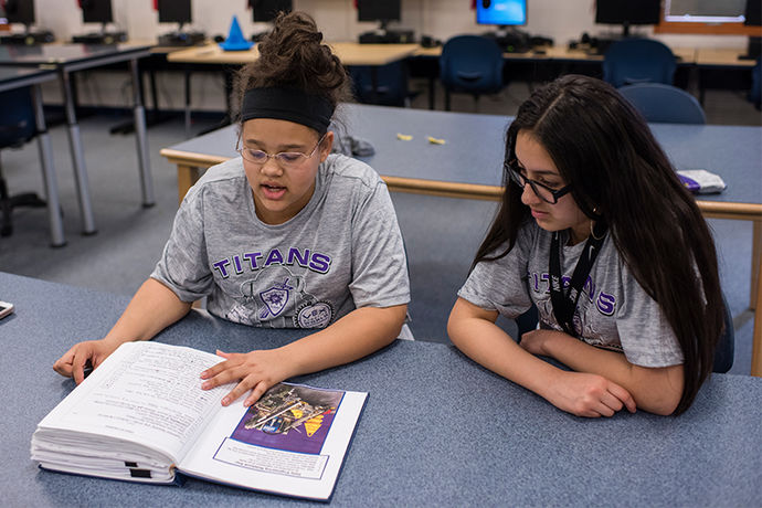 Jada McCall and Karen Gallegos study the team's 45-page engineering notebook.