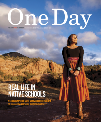 The cover of One Day Magazine, Fall 2014, featuring a young woman in Native American dress standing in front of a mountain.