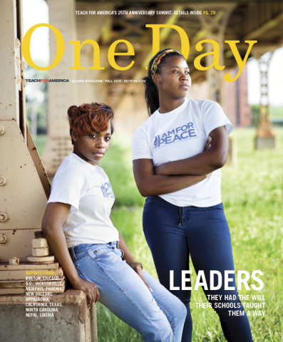 Cover of One Day Magazine, Fall 2015 issue, showing two high-school aged girls with brown hair, white shirts and blue jeans lounging underneath a raised railway.