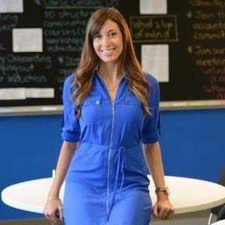 A young white woman wearing a blue dress.