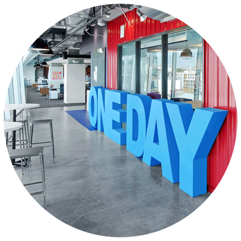 "icon showing an office space with a ""One Day"" standing logo block"