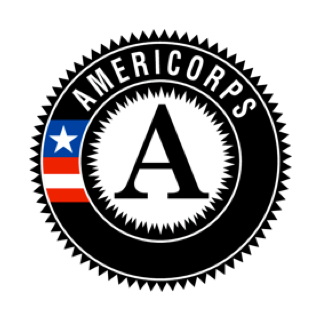 "A circular logo with a black background and text reading ""Americorps."""