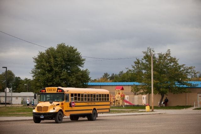 A school bus takes kids to and from school on the Reservation.