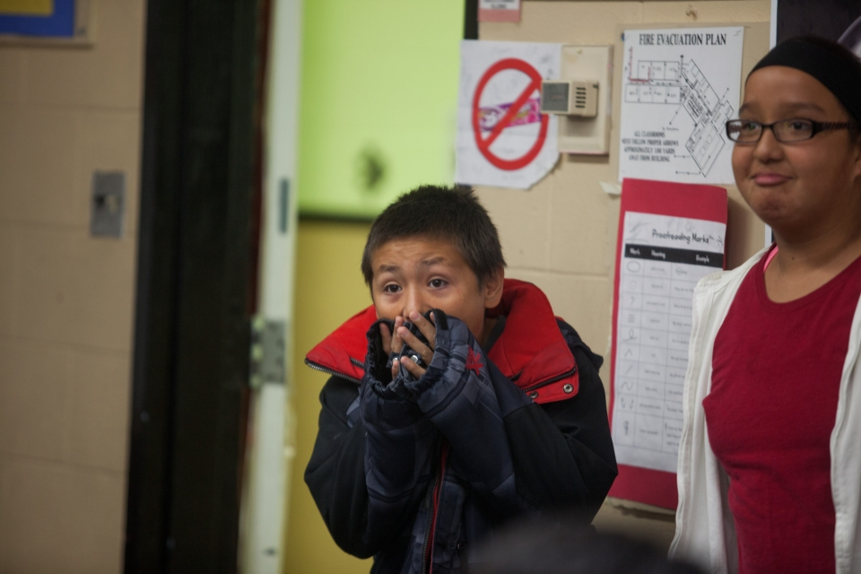 A student shows excitement in school on the Rosebud reservation.