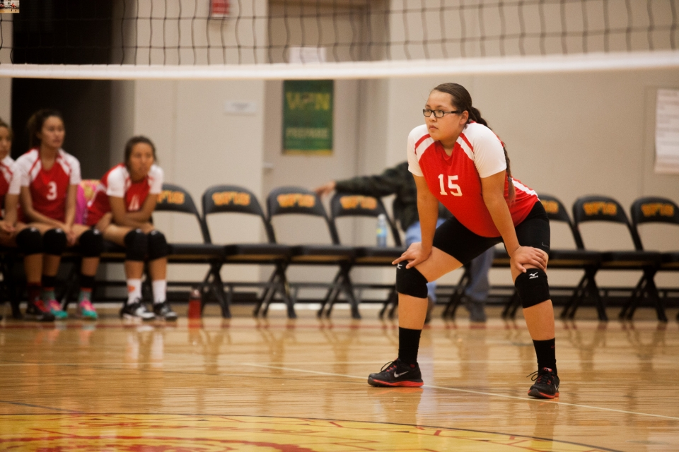 A student plays volleyball at her school on the Rosebud Reservation.