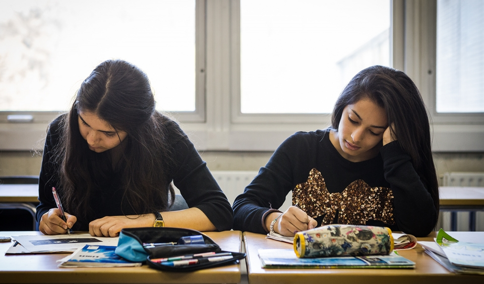 Two German students working in class.