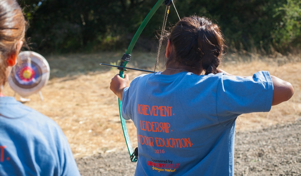 A girl practicing Archery