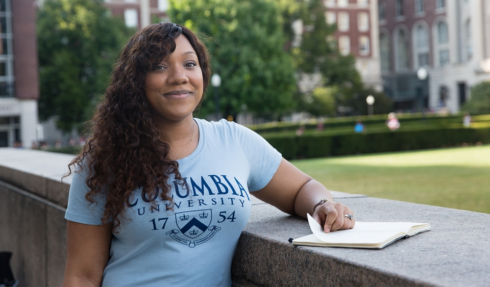 A woman wearing a Columbia shirt