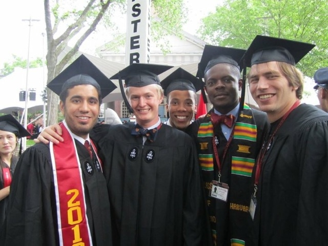 college graduates posing together