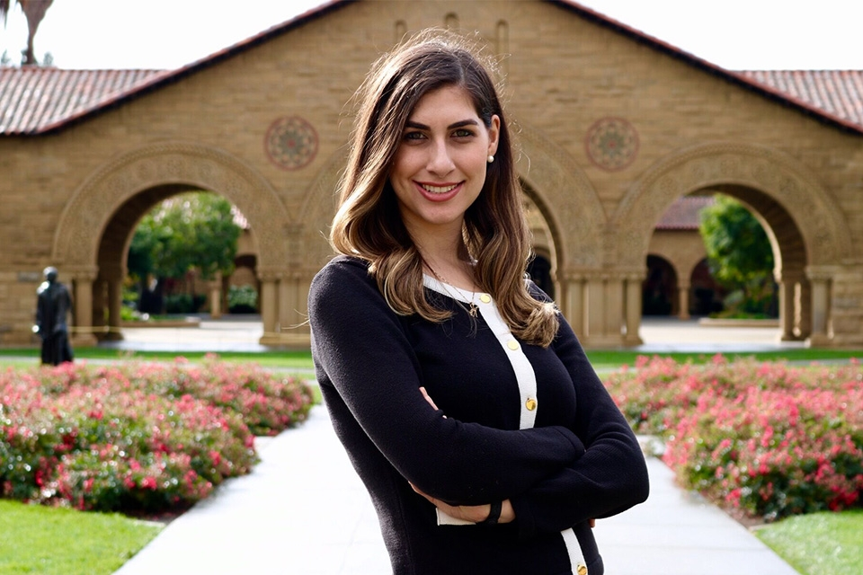 Woman standing with Stanford campus in background