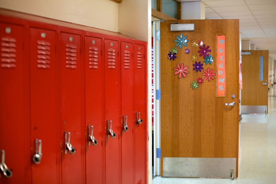 school hallway with open door to classroom