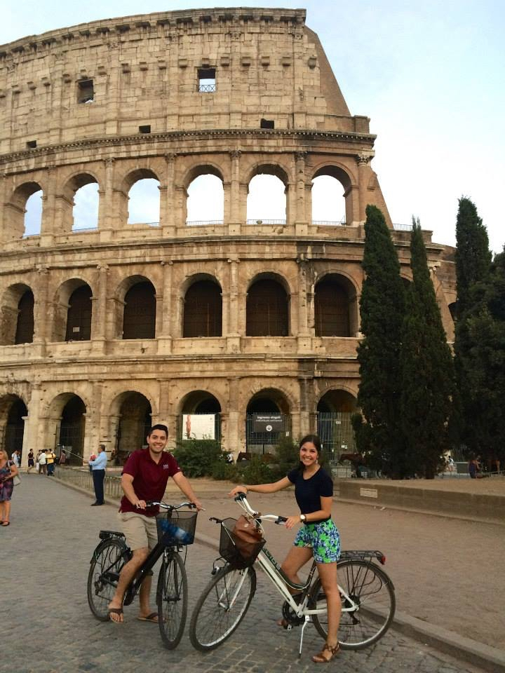Two people on bikes in Rome
