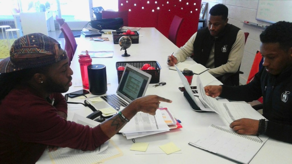 Profound Gentlemen Co-founders Mario Jovan Shaw (left) and Jason Terrell (upper right), working with program manager, Dominique Stone.