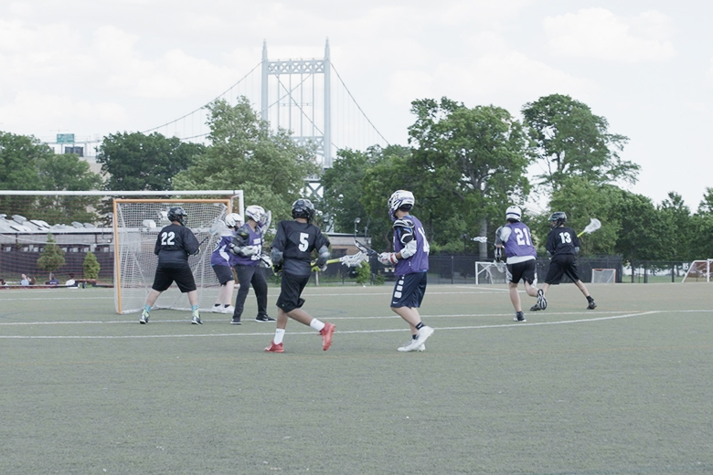 Students playing lacrosse in the bronx.