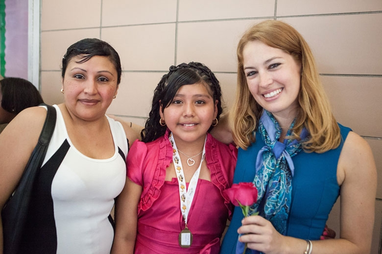 Young teacher with parent and student.