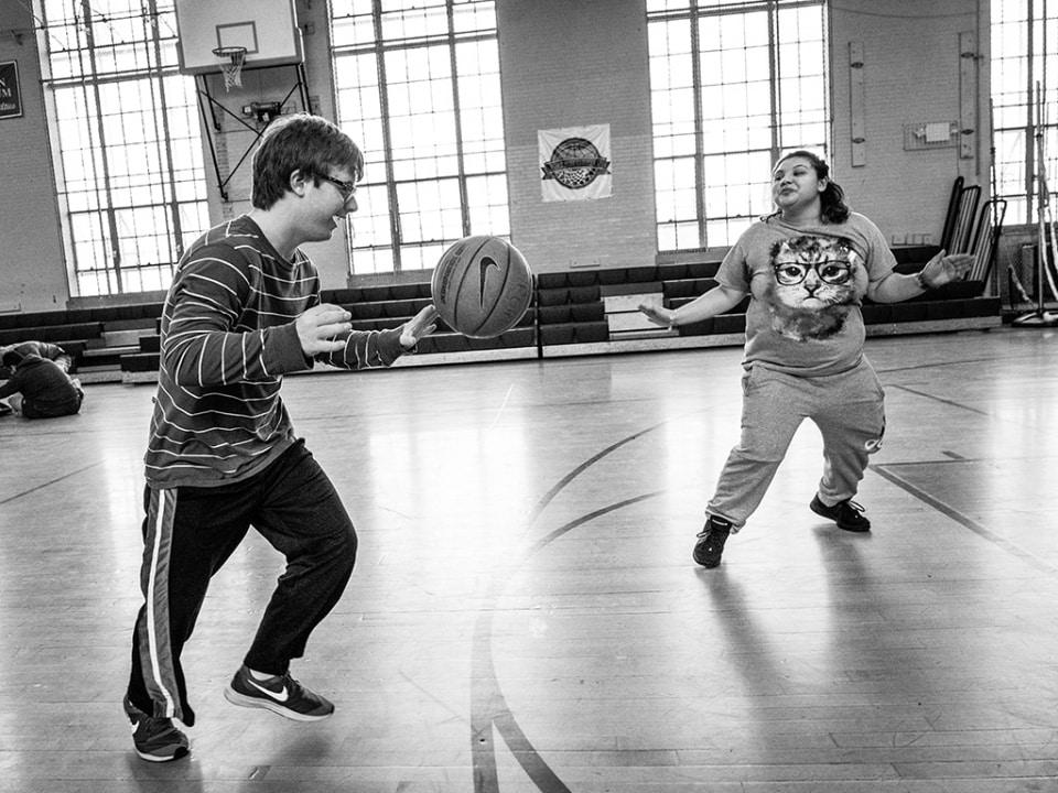 A young man playing basketball