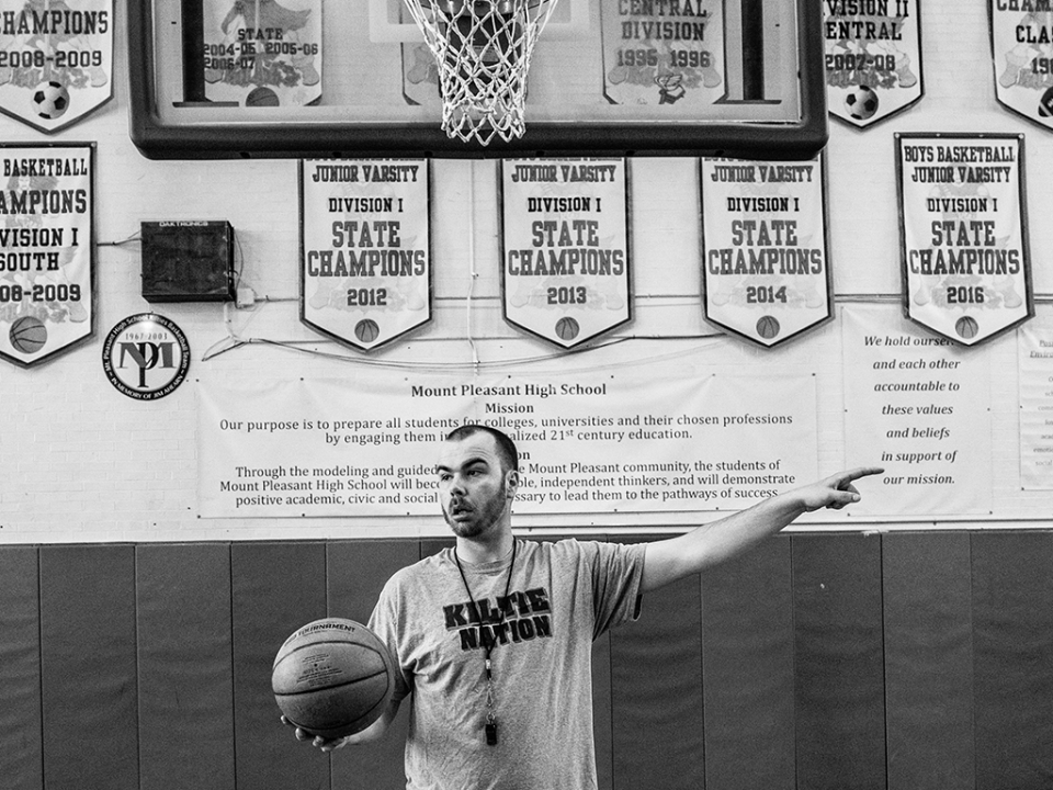 A coach holding a basketball