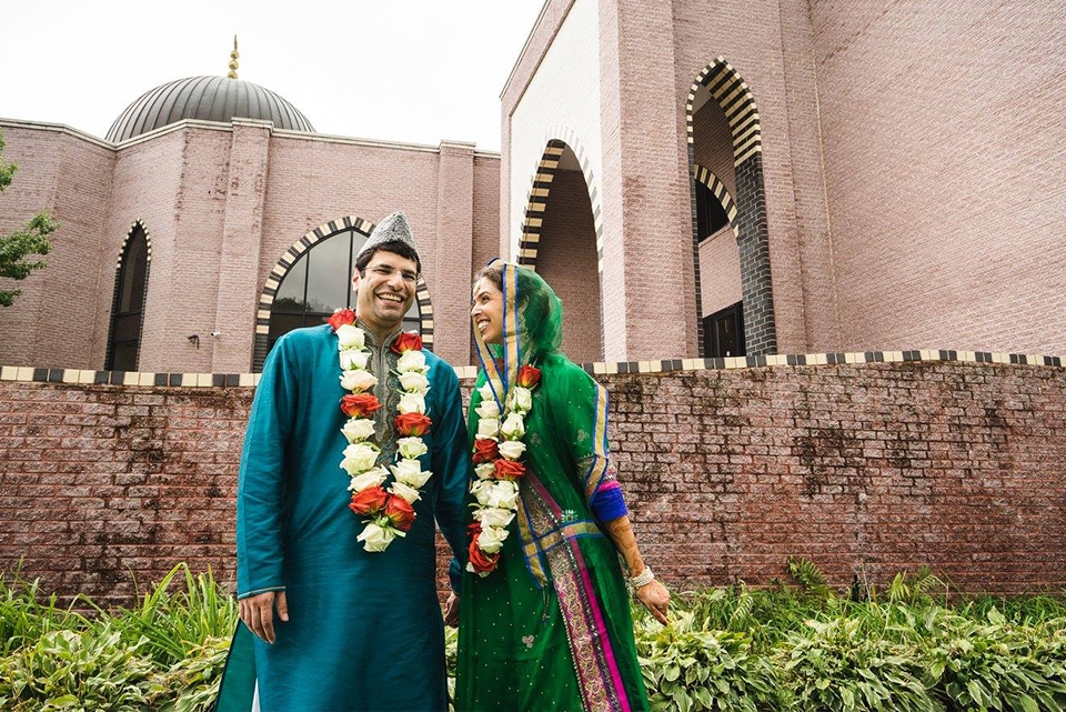 A couple poses on their wedding day