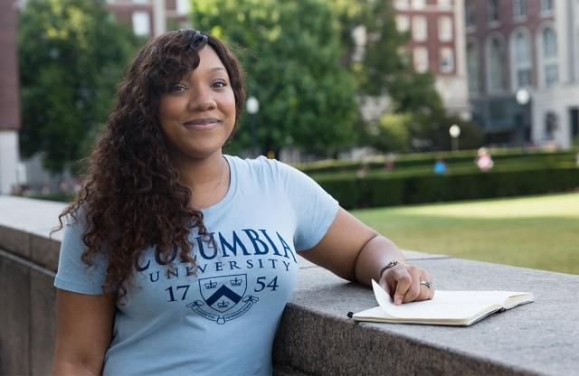 A woman wearing a Columbia shirt
