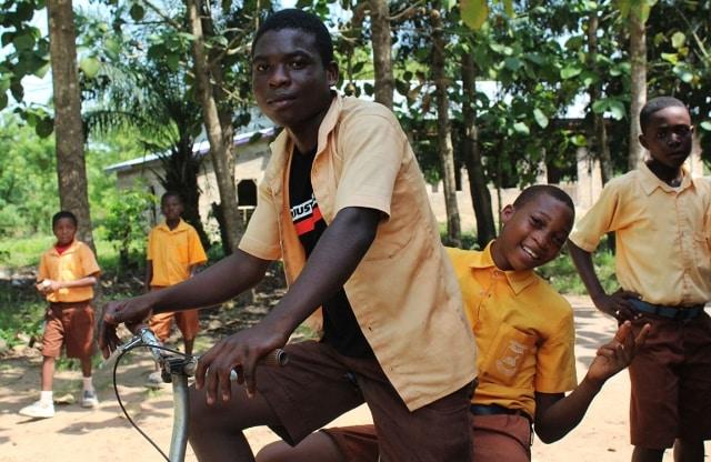 Students on a bike in Ghana