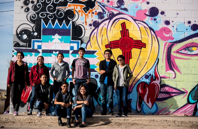 Kids in front of a mural