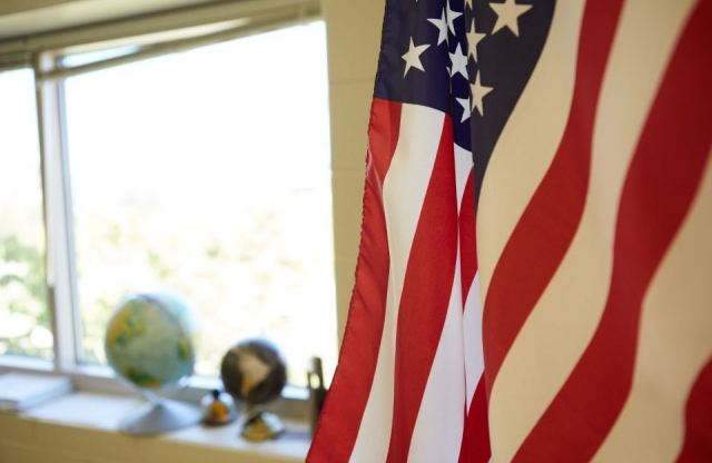 Flag and globes in classroom setting
