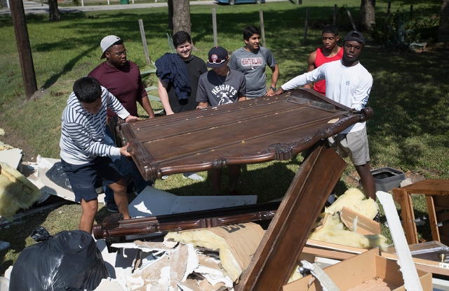 Students load damaged belongings