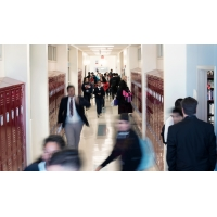 A school hallway with students walking.