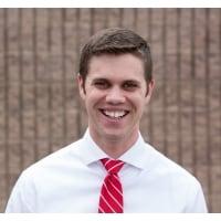Executive Director Nate Morrison smiling.